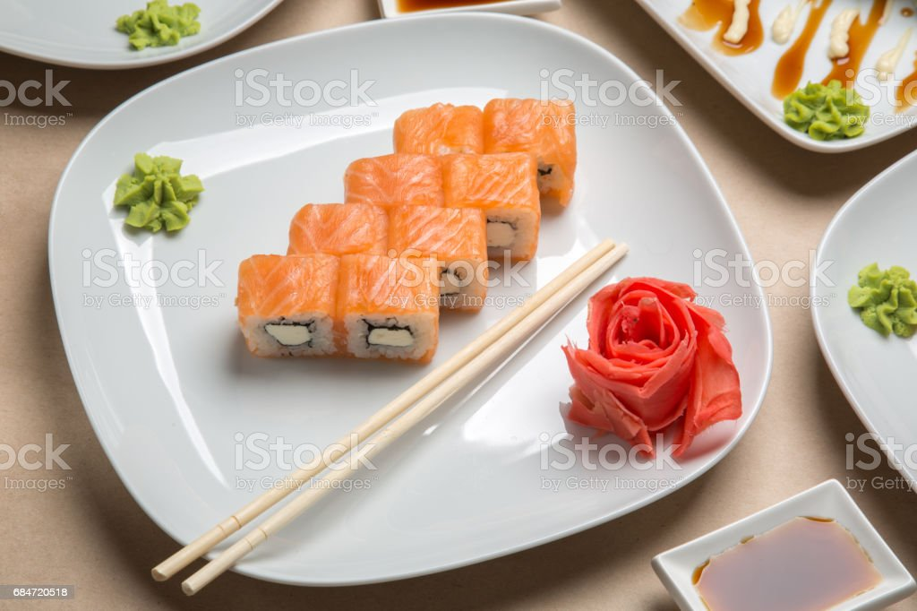 delicious rolls with salmon on the table stock photo