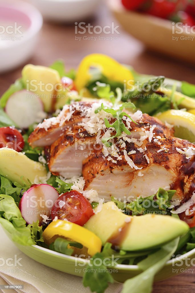 Delicious salad with grilled chicken slices and parmesan cheese royalty-free stock photo