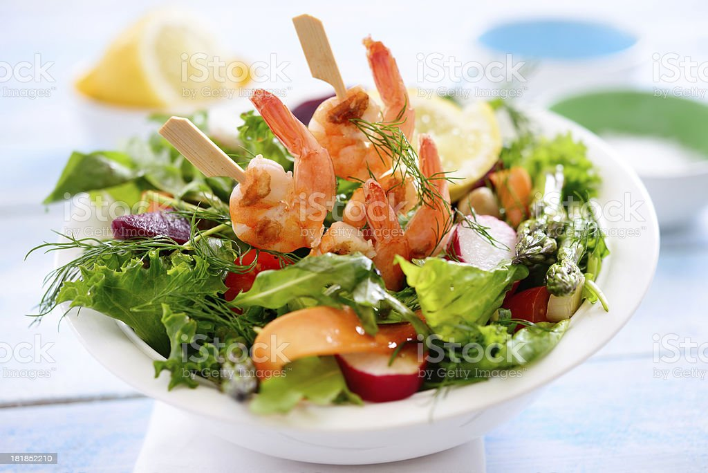 Delicious salad with shrimp skewers royalty-free stock photo