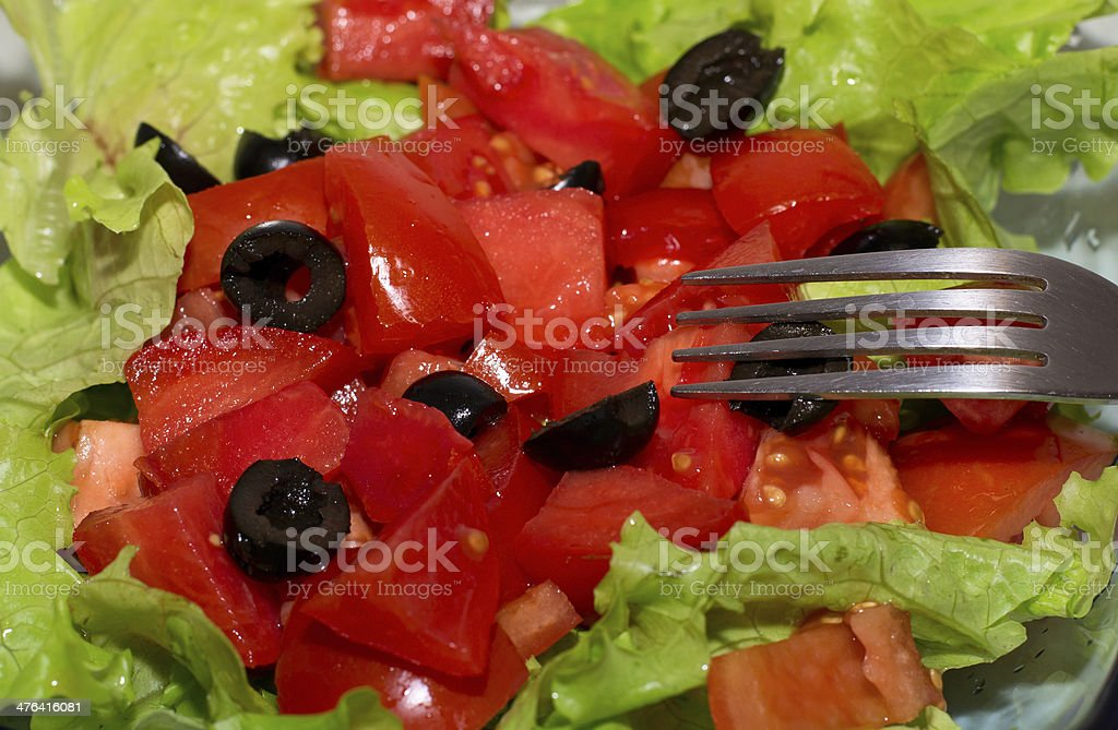 Delicious salad with  tomatoes, olives and peppers. royalty-free stock photo