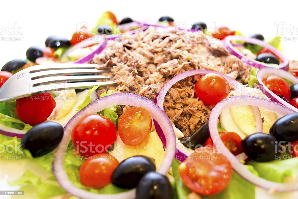 Delicious salad with tuna, tomatoes, eggs, olives and peppers. royalty-free stock photo
