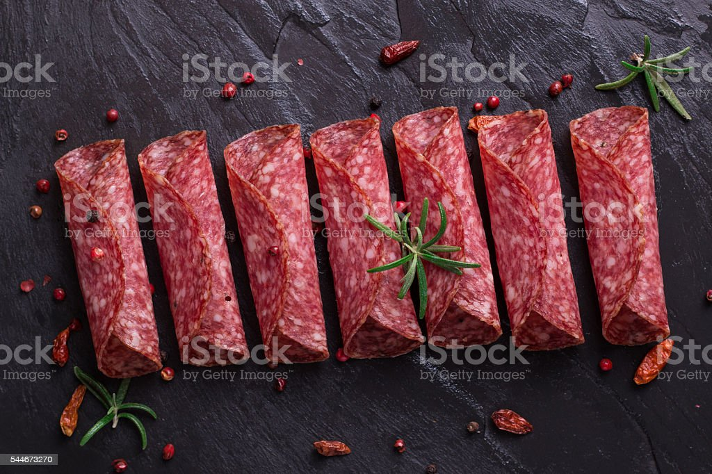 Delicious salami with basil and wine, selective focus stock photo