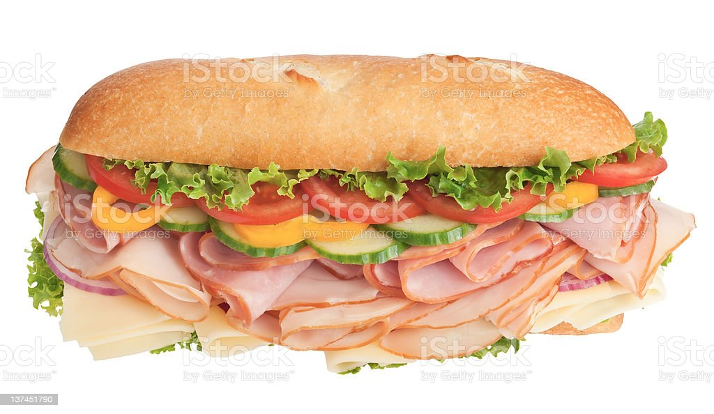 Delicious sandwich stuffed with veggies, cheese and deli meats royalty-free stock photo