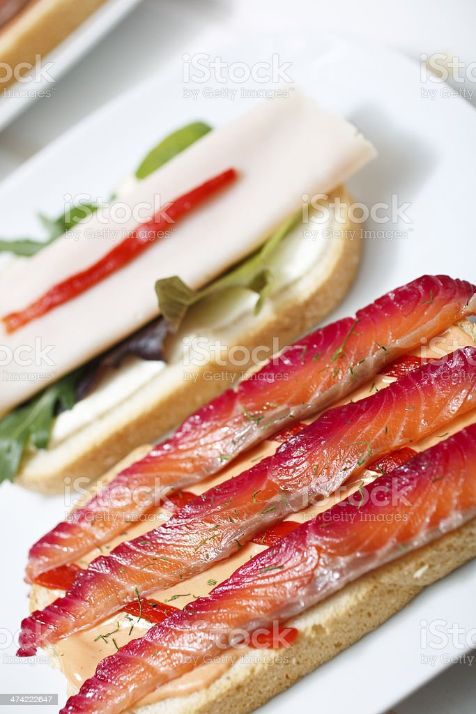 Delicious Sandwich with Gravlax and Ham stock photo