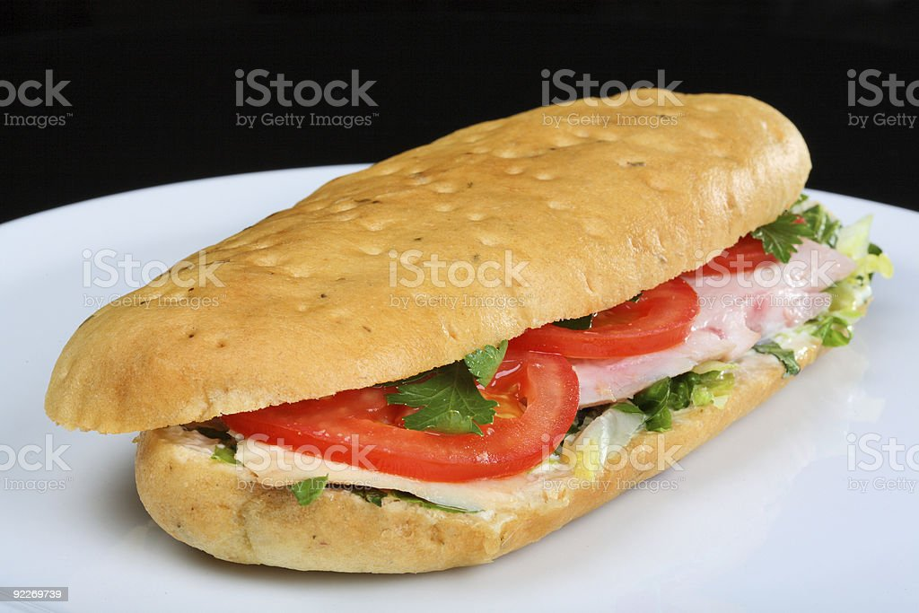 Delicious sandwich with tomatoes and chicken royalty-free stock photo