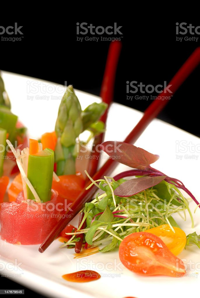 Delicious sashimi on a white plate with chop sticks royalty-free stock photo