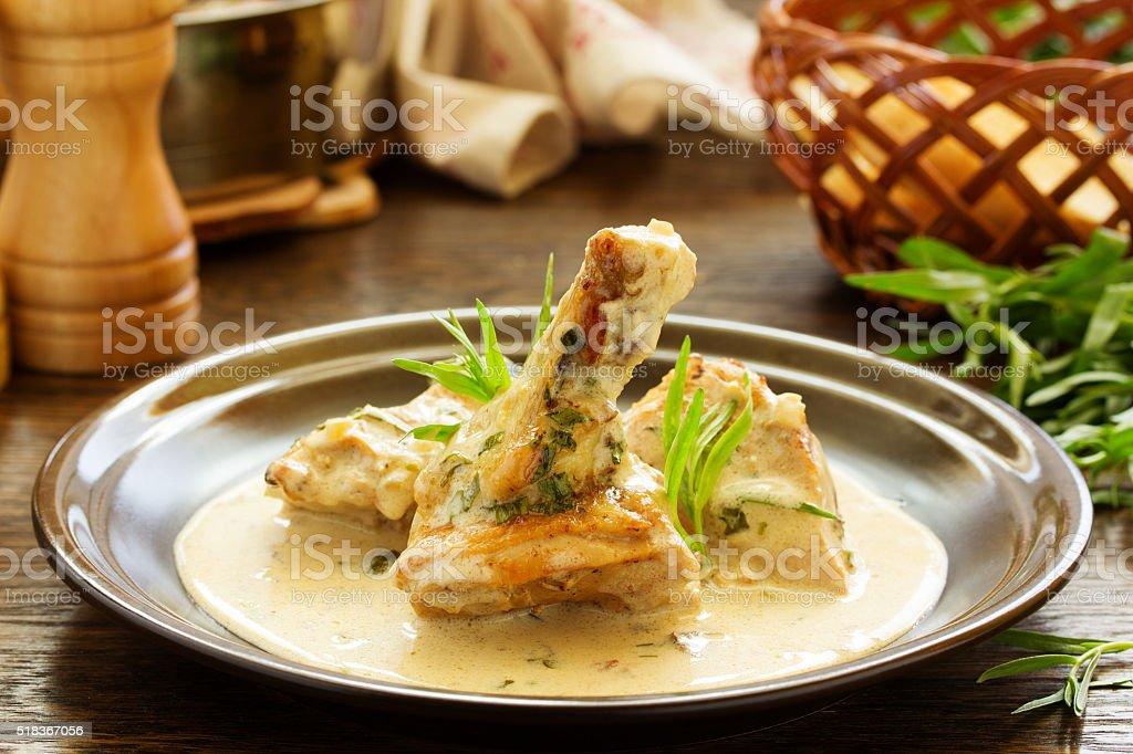Delicious sauteed chicken with tarragon. stock photo