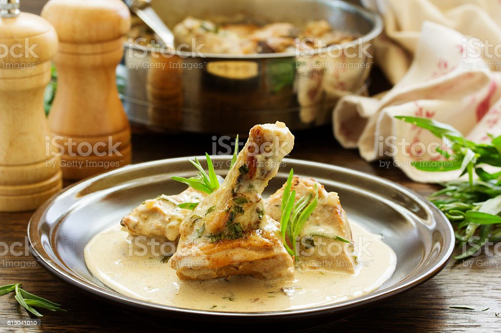 Delicious sauteed chicken with tarragon. stock photo