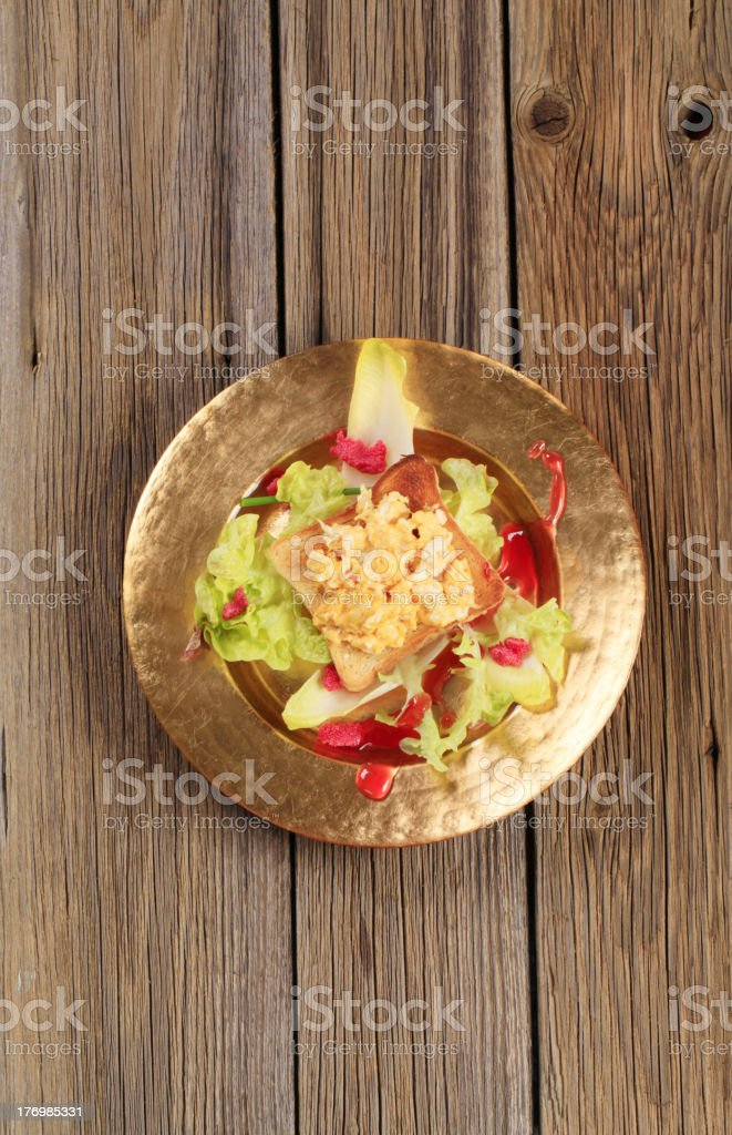 Delicious scrambled eggs caviar salad above royalty-free stock photo