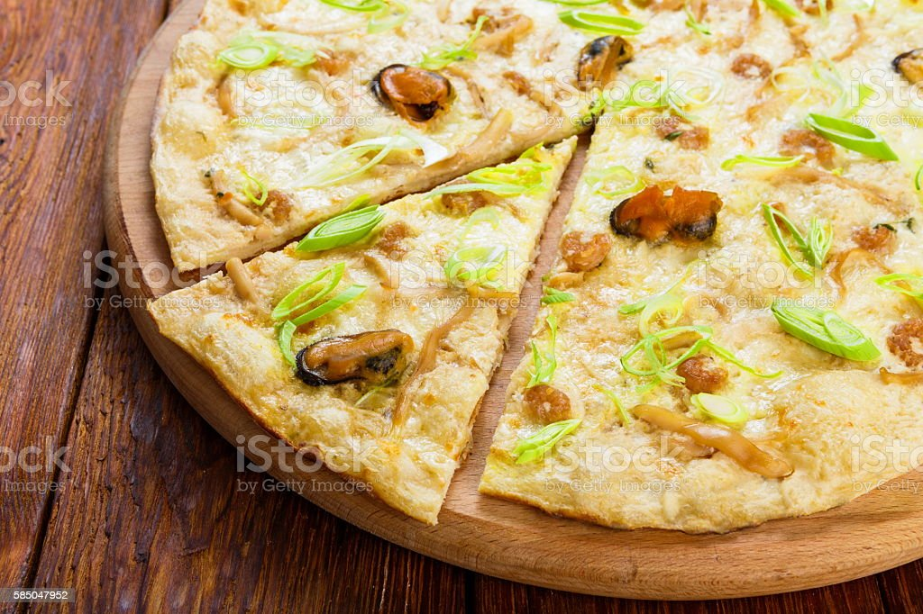 Delicious seafood pizza with olives stock photo