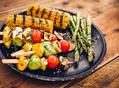 Delicious selection of grilled vegetable kebabs, corn and asparagus