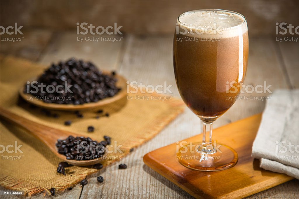 Delicious serving of fresh nitro coffee from tap organic ingredients stock photo