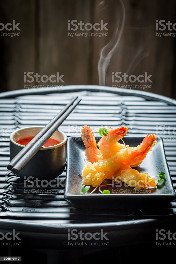 Delicious shrimp in tempura with red sauce stock photo