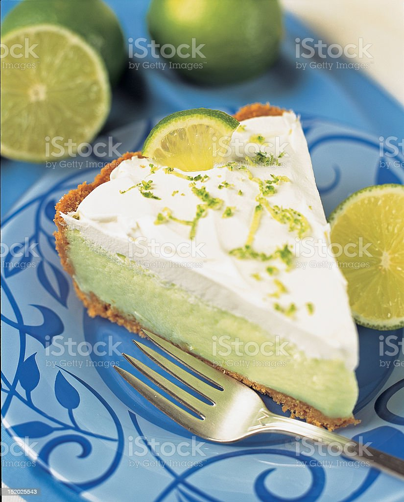 Delicious sllice of key lime pie on blue flowered plate royalty-free stock photo