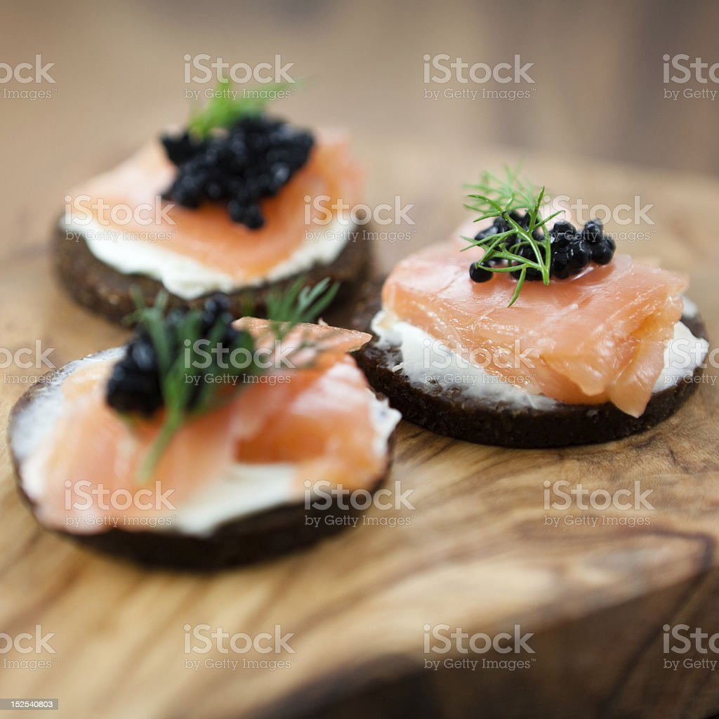 Delicious snack with salmon stock photo