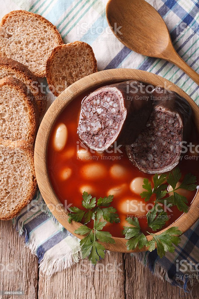 Delicious soup with black pudding Fabada asturiana vertical top stock photo