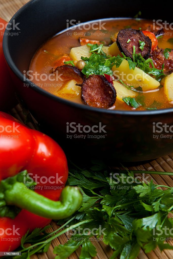 Delicious soup with paprika, tomatoes and potatoes royalty-free stock photo