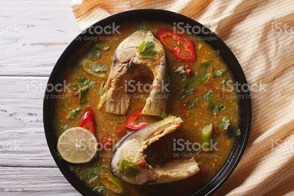 Delicious spicy fish curry with cilantro close up. Horizontal stock photo