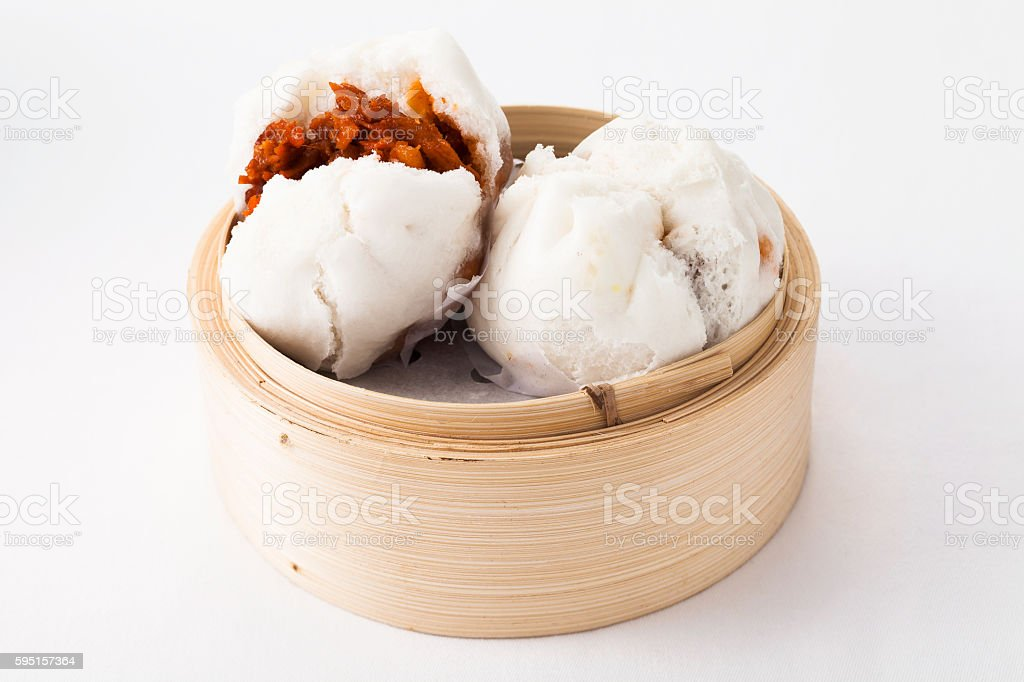 Delicious steamed buns in a bamboo steamer stock photo