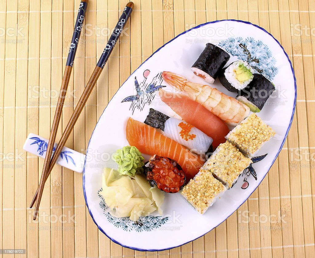 Delicious sushi, chopsticks and red caviar, top view royalty-free stock photo