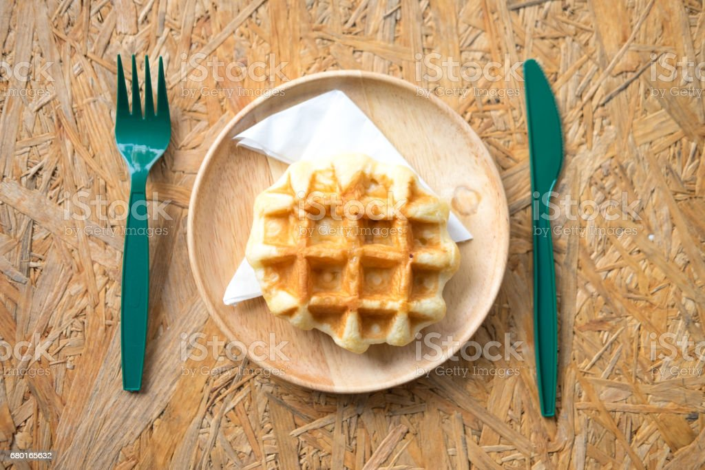 Delicious sweet dessert waffles on wooden, ready to eat stock photo