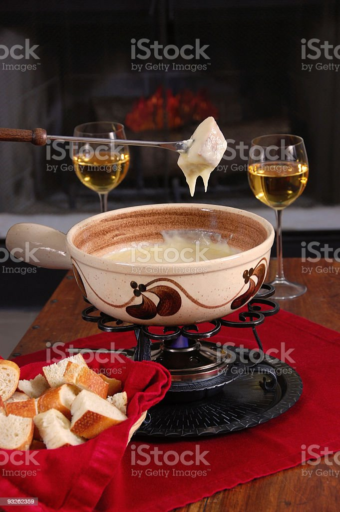 Delicious Swiss fondue in a pot stock photo