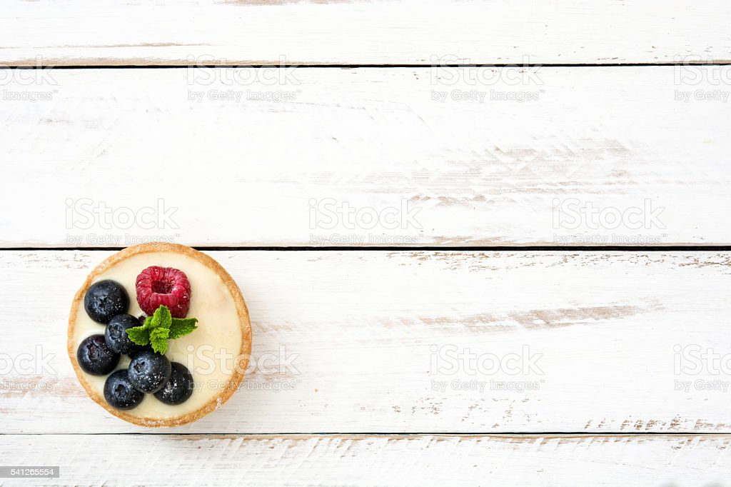 Delicious tartlet with raspberries stock photo