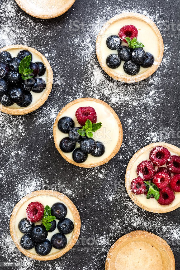 Delicious tartlets with raspberries stock photo