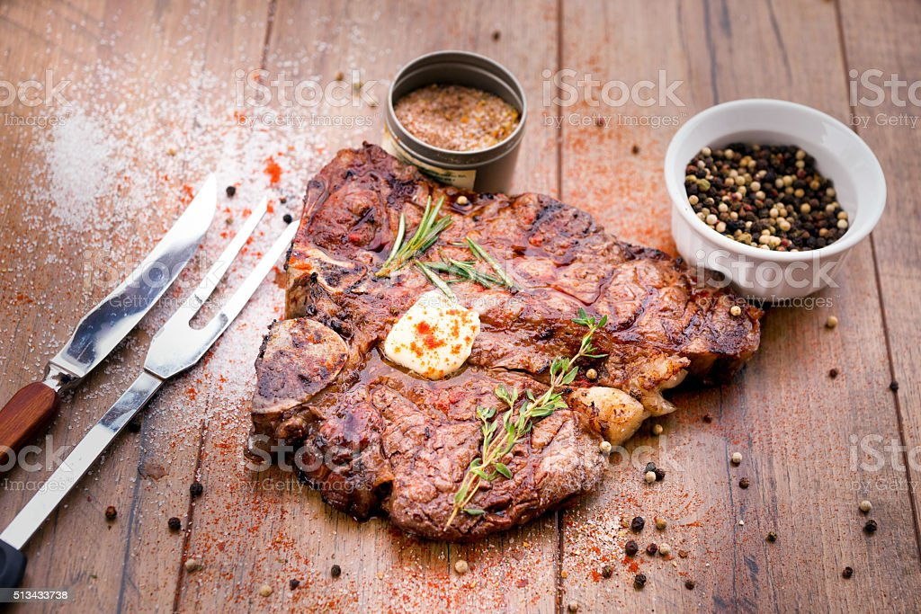 Delicious T-Bone Steak with Butter and Seasonings stock photo