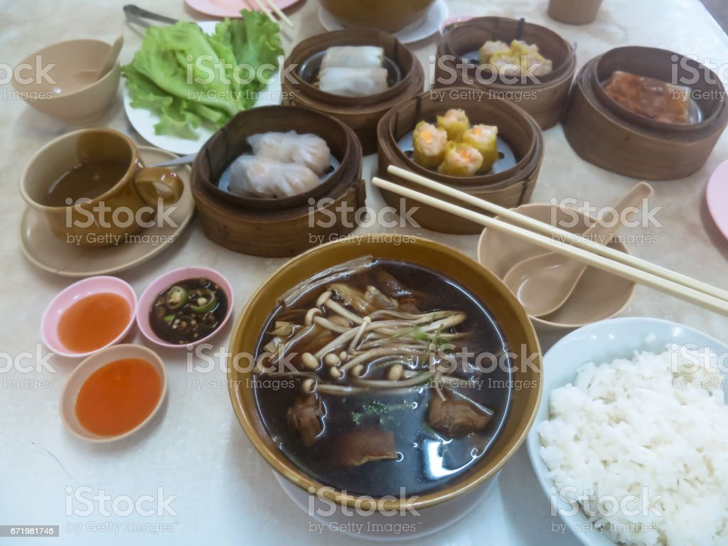 Delicious thai chinese style breakfast consisting of bak kut teh, dim sum dishes and a cup of coffee stock photo