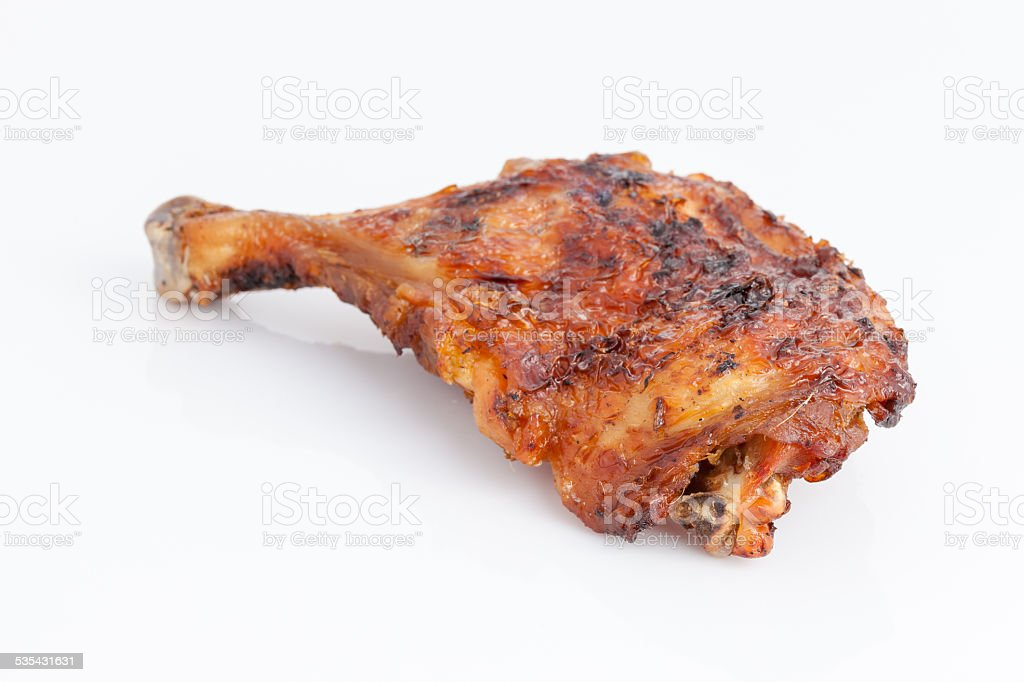 Delicious Thai style grilled chicken drumstick on white backgrou stock photo