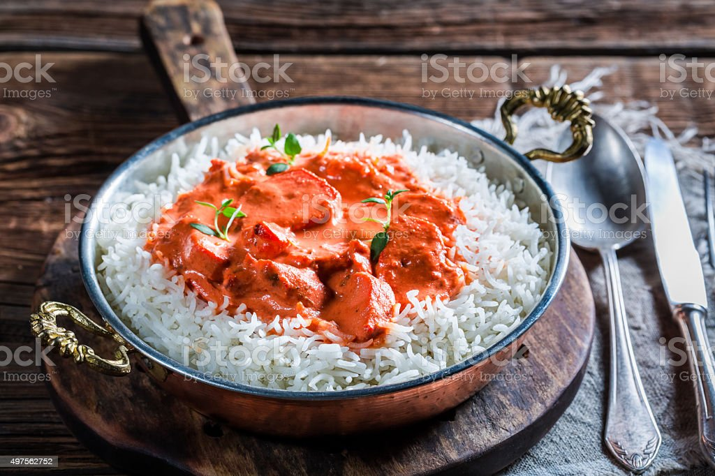 Delicious tikka masala with chicken in tomato sauce stock photo