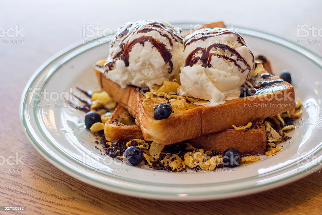 Delicious Toasted bread with vanilla ice cream in a plate stock photo