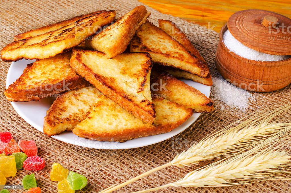 Delicious toasts, sugar bowl, spikelets and candy. stock photo
