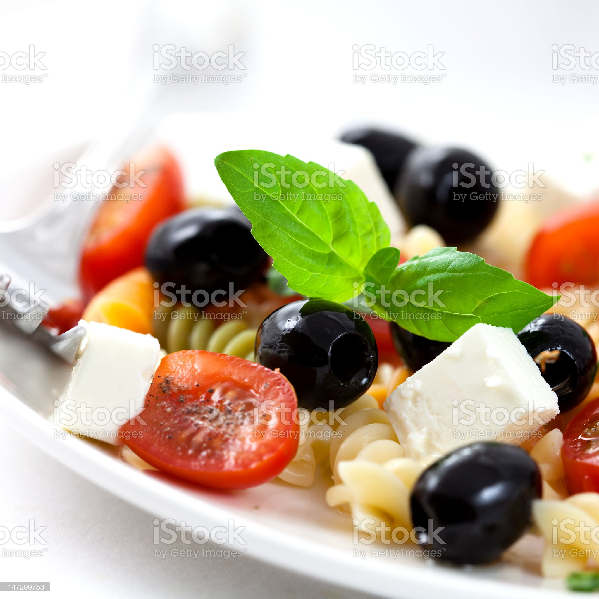 A delicious tomato herb and cheese pasta salad royalty-free stock photo