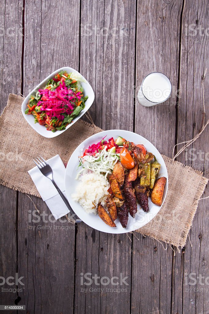 Delicious Turkish Kofte serving with fried potato (meatballs) stock photo