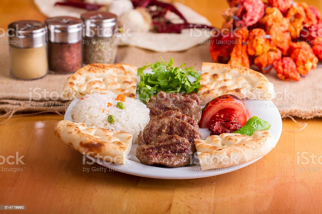 Delicious Turkish Traditional Kebab Kofte with pilaf (meatballs) stock photo