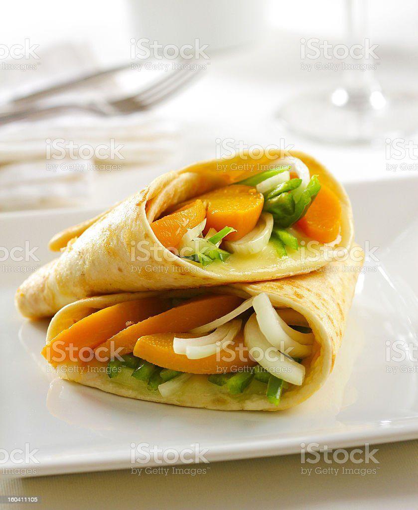 Delicious vegetable tortilla wrap with melted mozarella cheese royalty-free stock photo