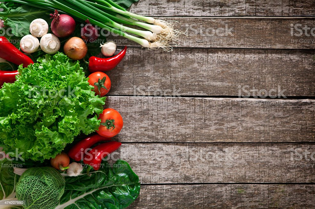 delicious vegetables on a wooden base stock photo