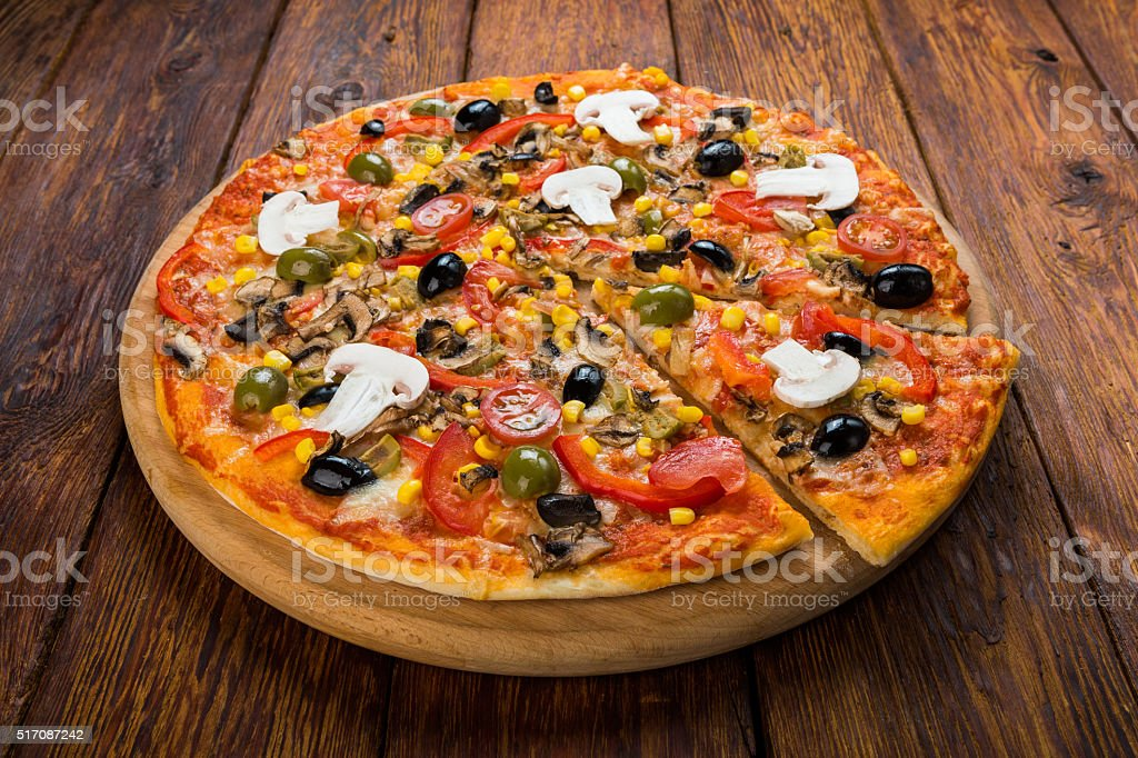 Delicious vegetarian pizza with tomato, mushrooms stock photo