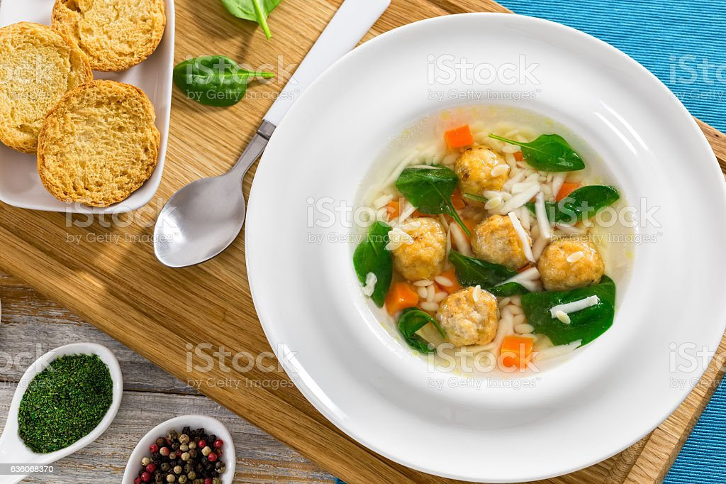 delicious wedding soup with meatball, carrots and spinach stock photo