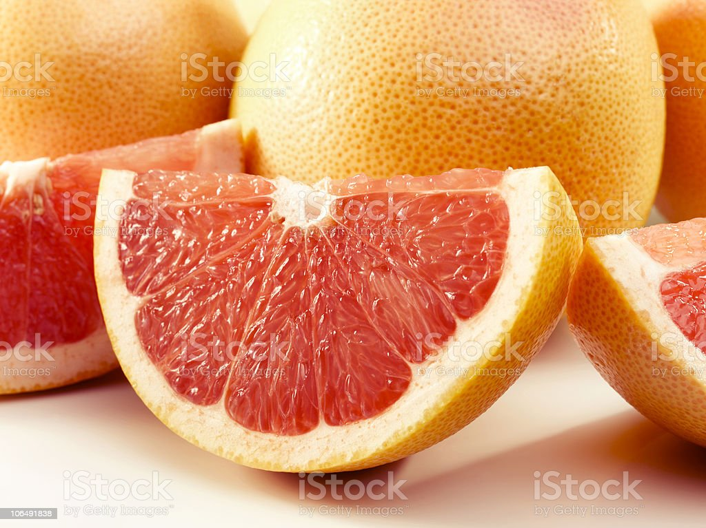 Delicious wedges of grapefruits stock photo