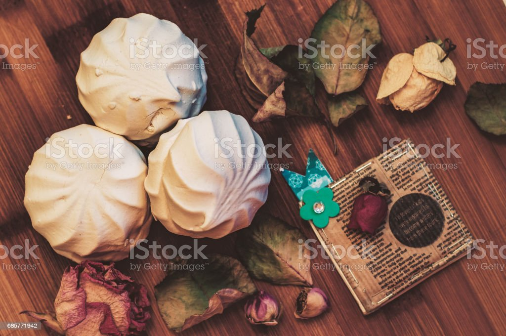 Delicious white marshmallow on a textured wooden surface. Zephyr. stock photo