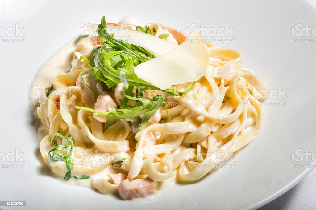 Delicious white sauce chicken pasta stock photo