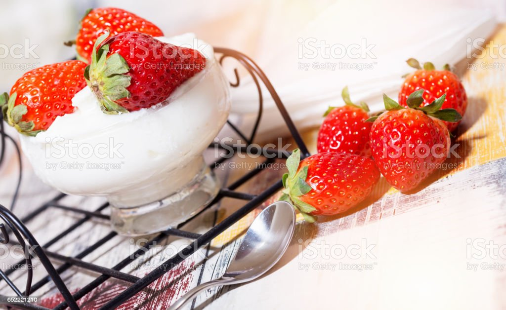 Delicious yogurt with Strawberry on table, close-up stock photo