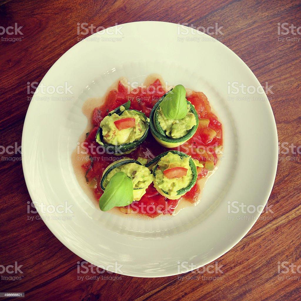 Delicious zucchini rolls with guacamole stock photo