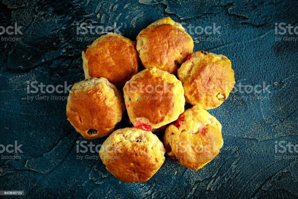 Deliciuos cherry and sweet sultanas home made scones stock photo
