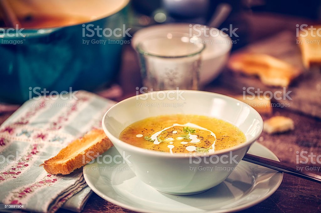 Delicous Chicken Soup with Carrots and Parsnips stock photo