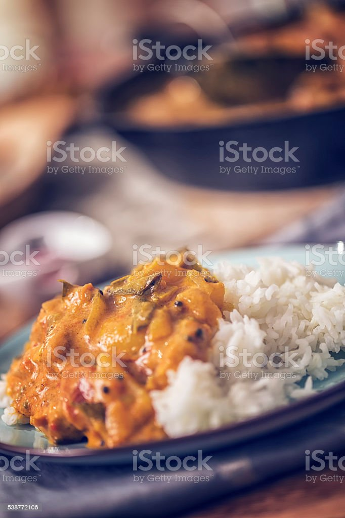 Delicous Homemade Chicken Curry Dish with Rice stock photo