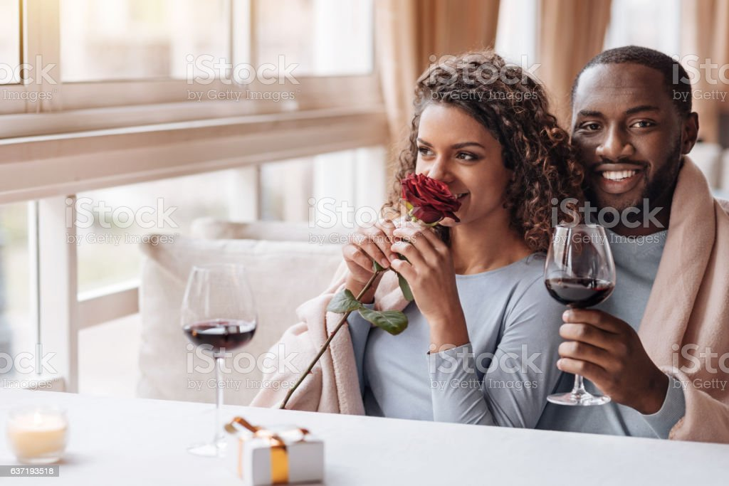 Delighted African American couple hugging in the restaurant stock photo